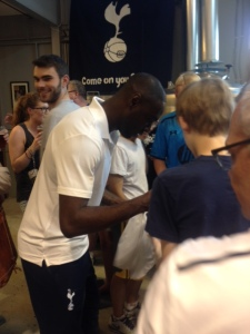 King signing autographs for fans.